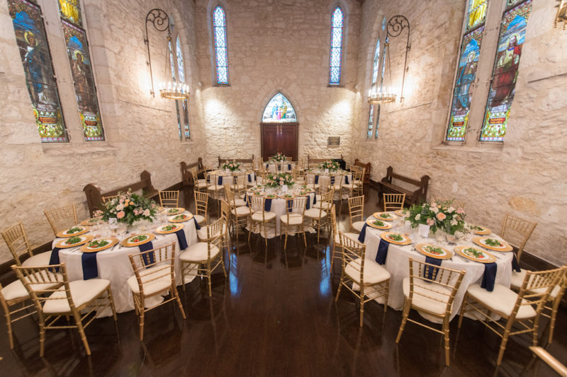 Beautiful cathedral setting with stainless windows with event tables set-up.